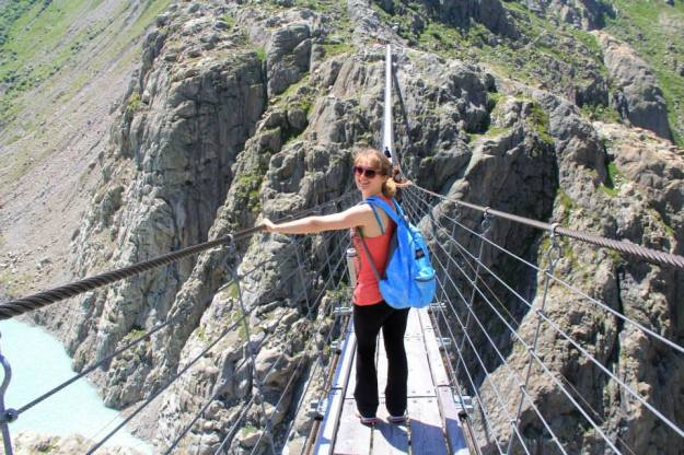 Walking timidly across the Trift Suspension Bridge.