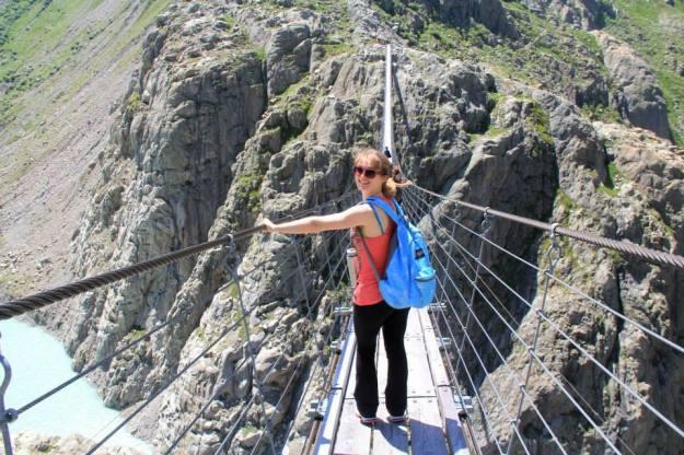 Walking timidly across the Trift Suspension Bridge.